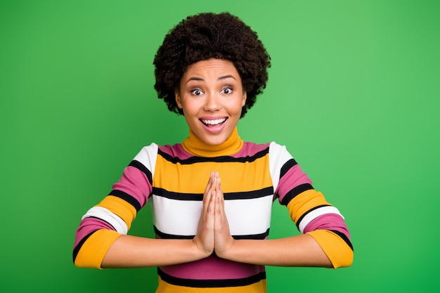 Portrait of amazed crazy funky afro american girl hear want wait gift present gift incredible scream unbelievable put hands together wear trendy outfit