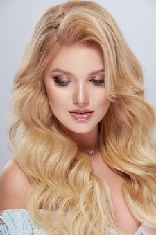Portrait of amazing blondie woman with beautiful hairstyle