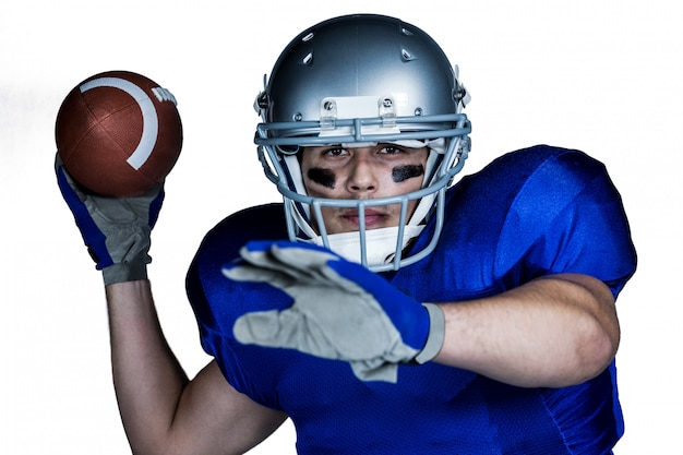 Portrait  of american football player with ball playing