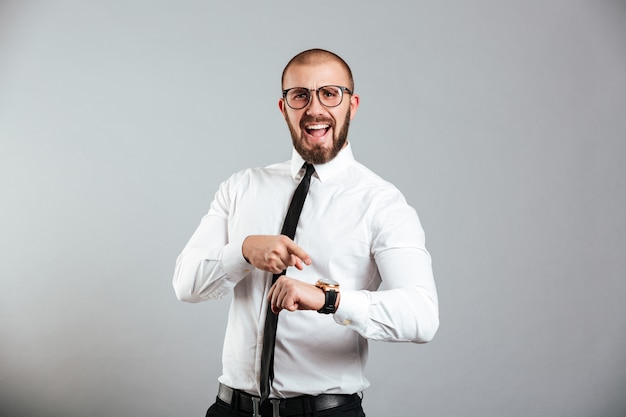 Portrait of an angry businessman pointing