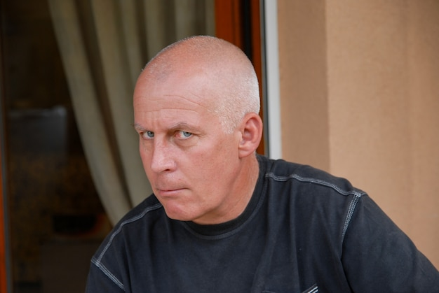 Portrait of angry mature man outdoors