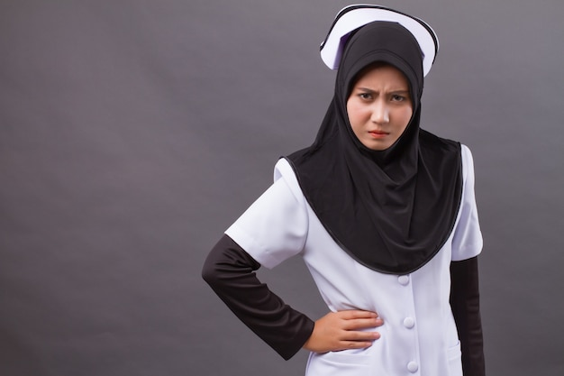 Portrait of angry muslim nurse