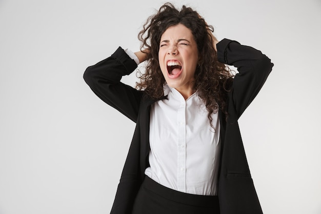 Portrait of an angry young businesswoman screaming