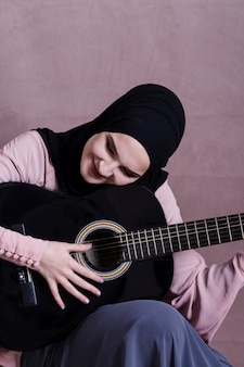 Portrait of arab woman with guitar