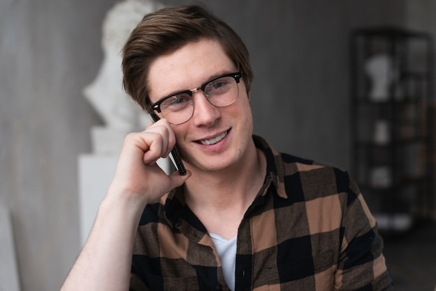 Portrait of artist talking on the phone