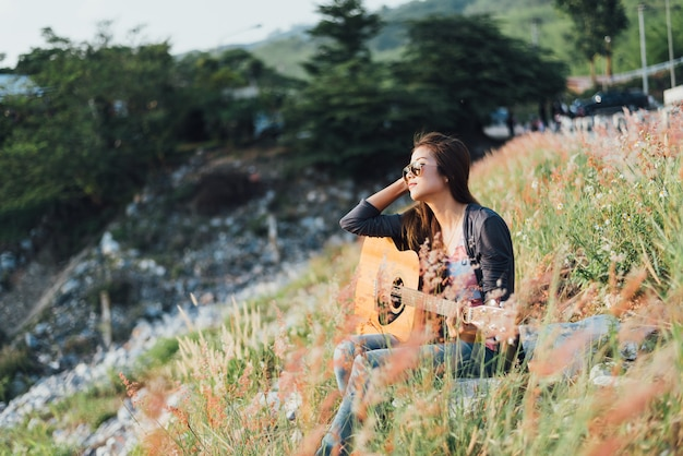 Portrait asia women with guitar