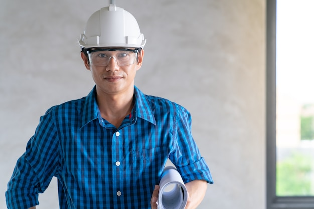 Portrait of asian architect man in construction renovation site