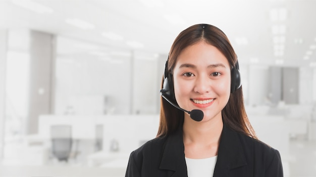 Portrait of asian beautiful smiling woman customer support phone operator