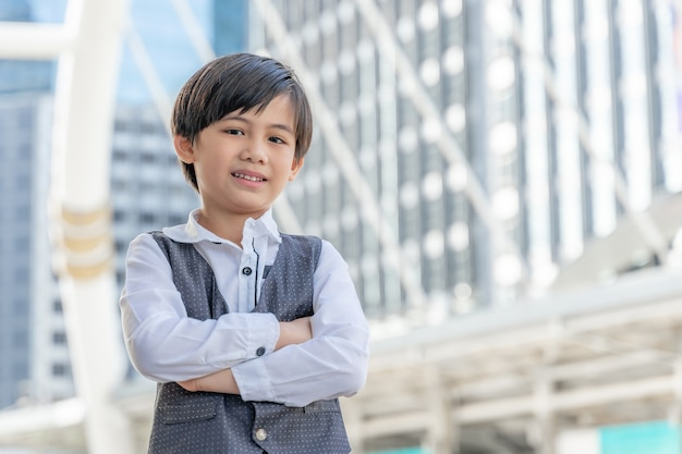 Portrait asian boy on business district , lifestyle children kid people concept