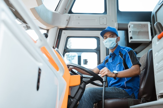 Portrait of asian bus driver wearing uniform and mask