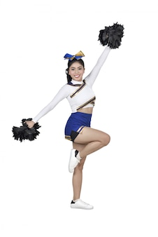 Portrait of asian cheerleader with pom poms