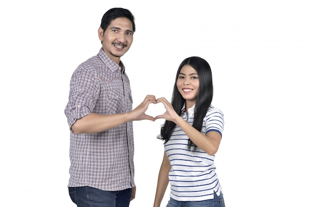 Portrait of asian couple in love making heart shape from their fingers
