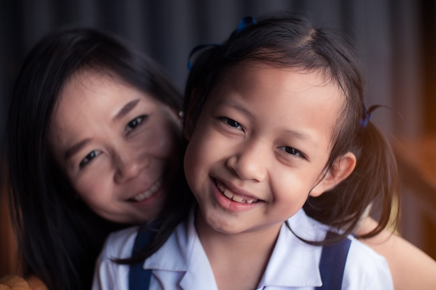 Portrait of asian daughter and mother smile with happy