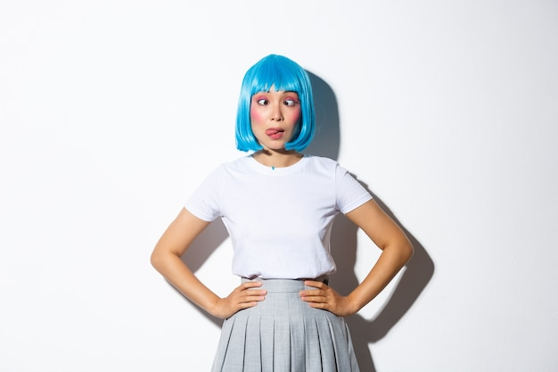Portrait of an asian girl in a blue short wig
