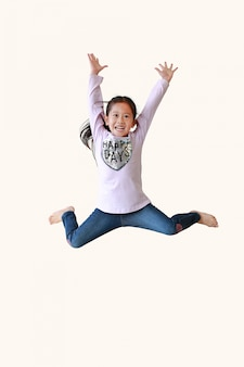 Portrait of an asian girl jumping