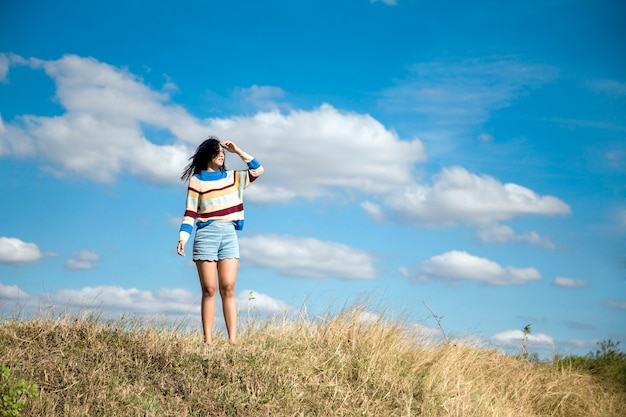 Portrait asian girl relaxation on hill with sky