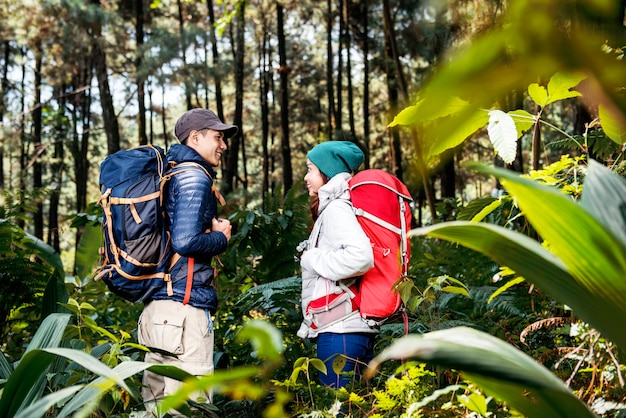 Portrait of asian hikers couple standing and looking each other