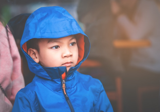 Portrait of asian kid boy in blue winter clothing