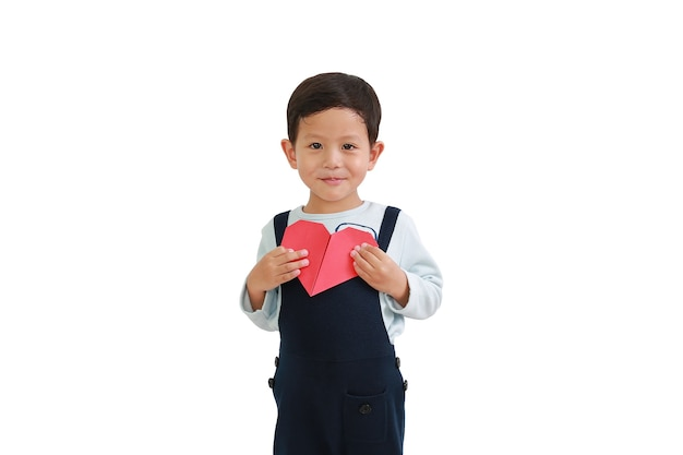 Portrait of asian little baby boy holding red heart sign on chest over white background. image with clipping path