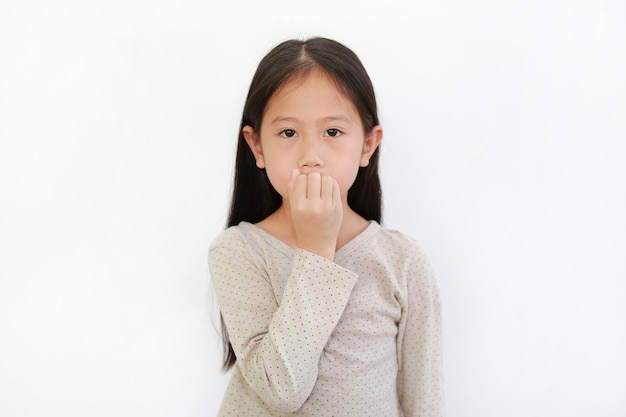 Portrait of asian little child girl sucking fingers in mouth isolated on white background.