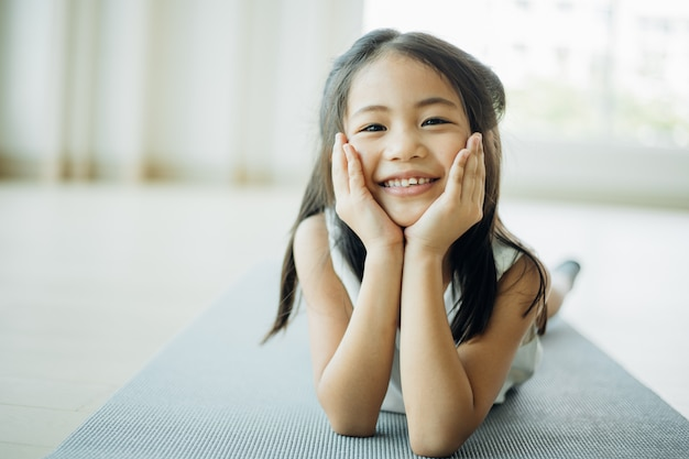 Portrait asian little girl in living room smiling and happy