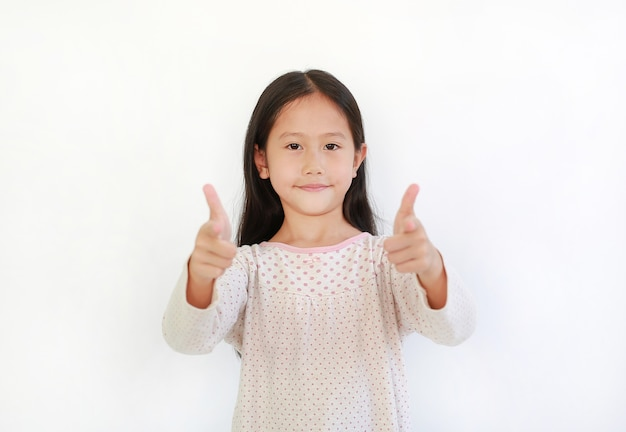 Portrait asian little kid girl child pointing at you and looking camera