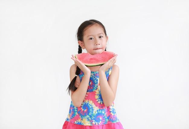 Portrait asian little kid girl eating watermelon isolated on white background