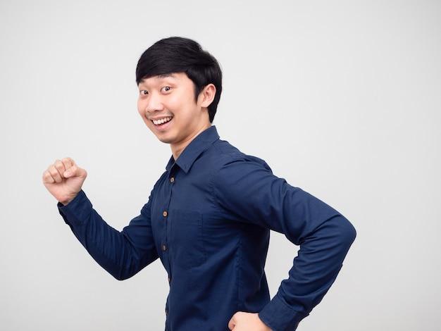 Portrait asian man run gesture happy smile face white background