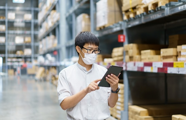 Portrait asian men, staff, product counting warehouse control manager standing, counting and inspecting products in the warehouse