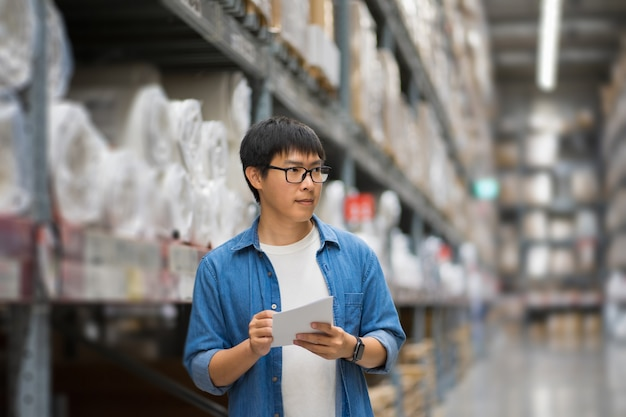 Portrait asian men, staff, product counting warehouse control manager