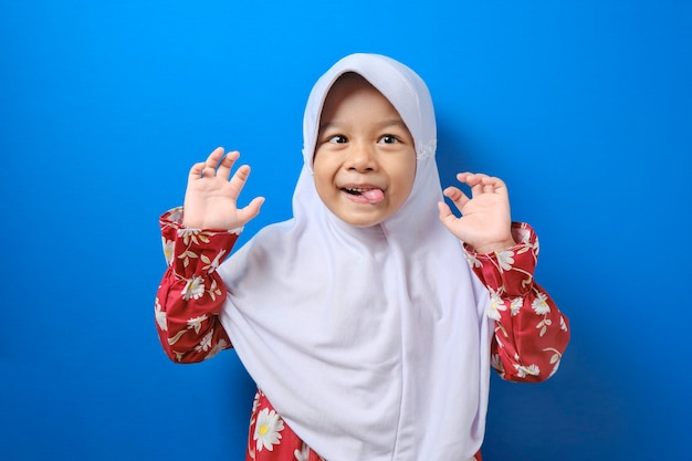 Portrait of asian muslim girl wearing hijab showing very lazy unhappy bored and tired gesture