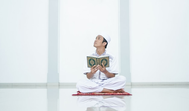 A portrait of an asian muslim man recite at mosque
