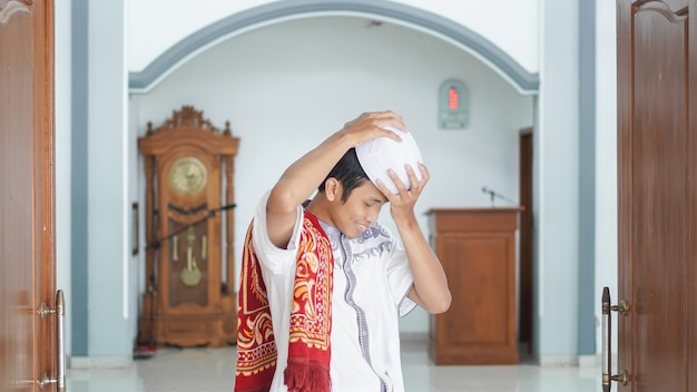 A portrait of an asian muslim man stylish at mosque, after sholat