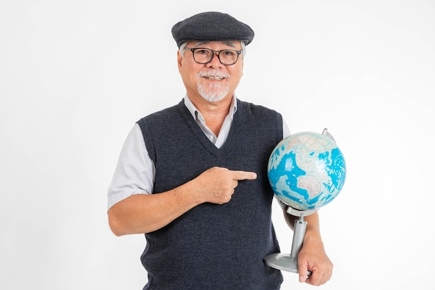 Portrait asian senior man , old man pointing at the globe earth world map in hand