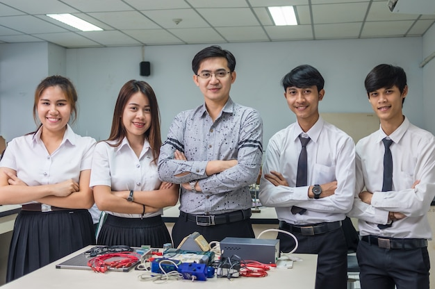 Portrait of asian teacher and college students in the laboratory classroom