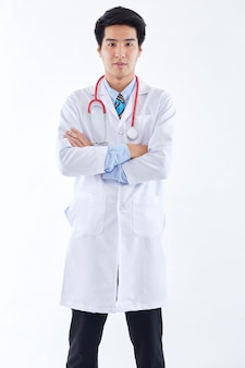Portrait asian thai medical male doctor on white wall