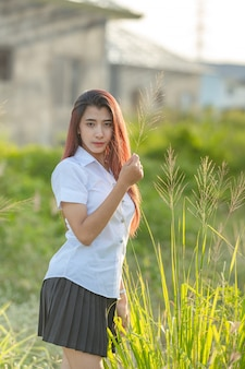 Portrait of asian or thai student university uniform beautiful girl relax and smile