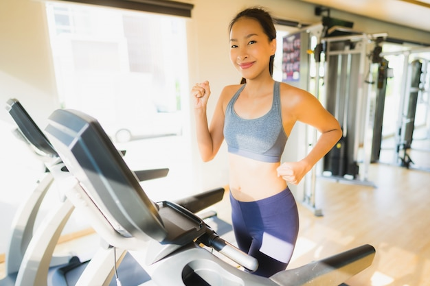 Portrait asian woman exercising and workout by running in gym