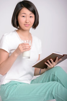 Portrait of asian woman, resorts and reads a book.