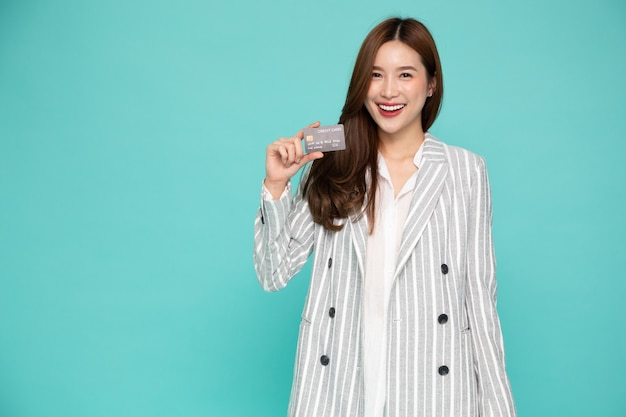 Portrait asian woman in suit holding credit card