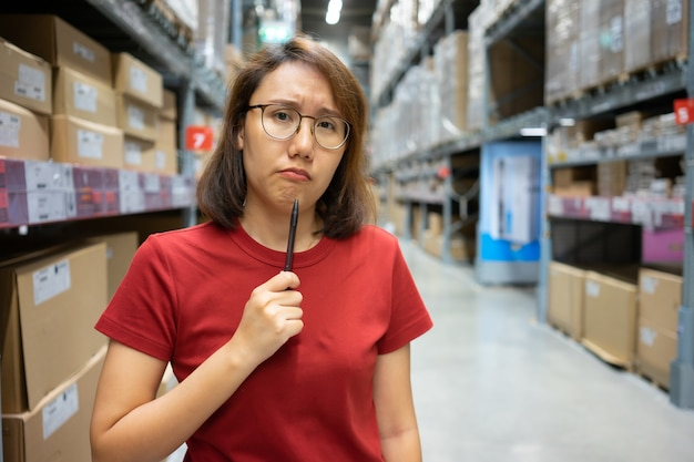 Portrait asian women, staff, product counting warehouse control manager standing,
