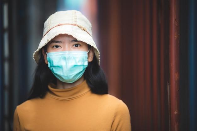 Portrait of asian women wearing medical face mask, coronavirus pandemic