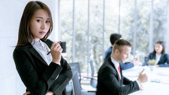 Portrait asian young business woman leader teamwork in meeting company office