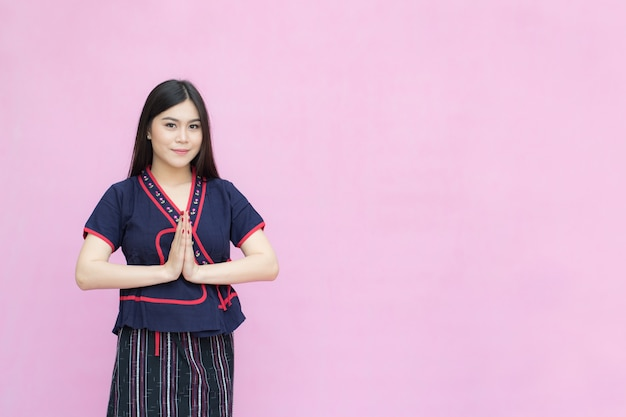 Portrait of asian young girl in traditional thai dress praying