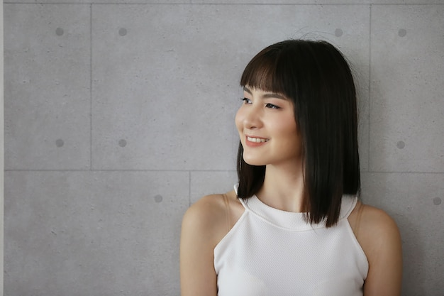 Portrait of asian young woman smiling posed