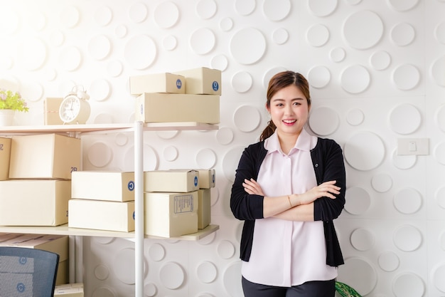Portrait asian young women standing smile in home office, start up small business sme