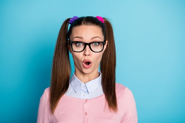 Portrait of astonished school girl look unbelievable graduate lesson test impressed open mouth