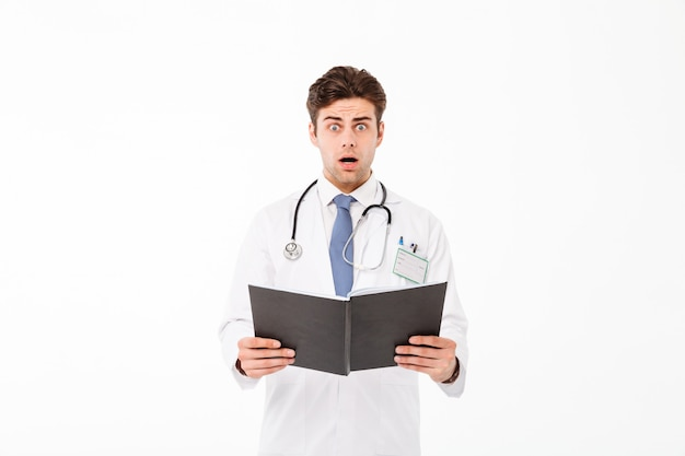 Portrait of an astonished young male doctor