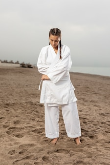 Portrait of athletic girl in karate outfit