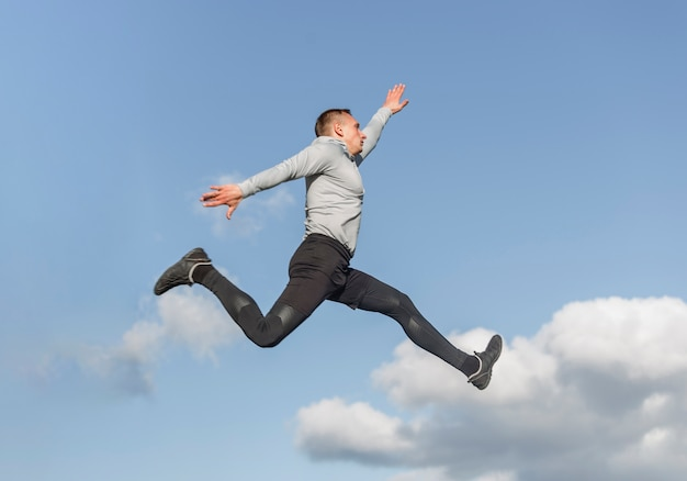 Portrait of athletic man jumping